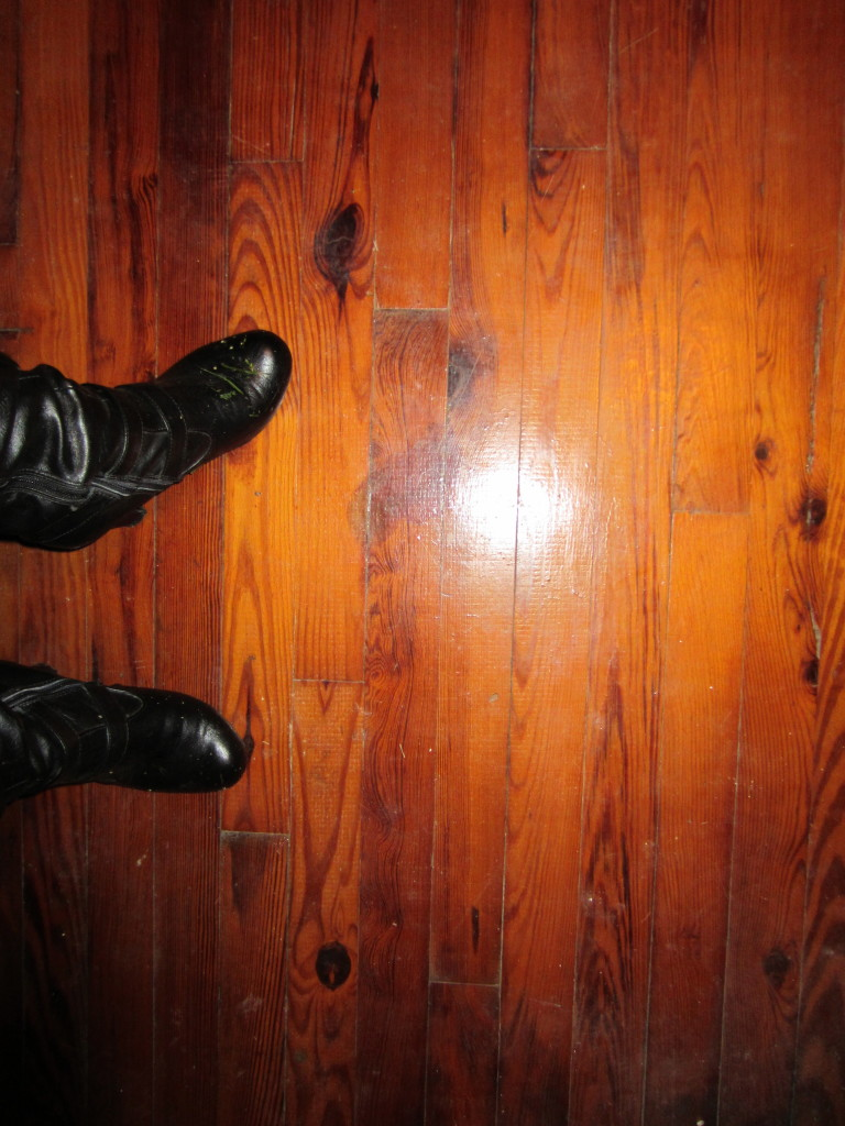 Blood stain on the floor of the operating room to the right of my upper boot.  And aren't they cute boots?