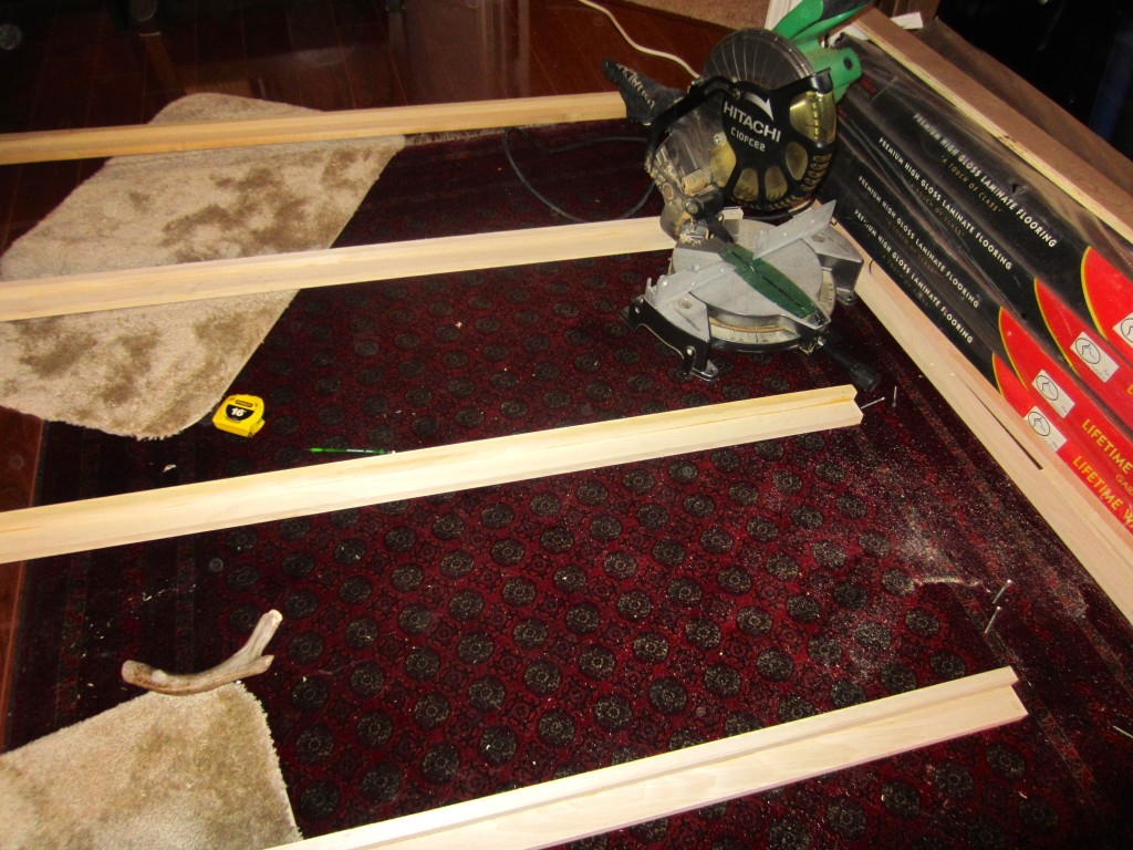 Yes, that is a miter saw on my very nice Afghan carpet.  It's surprisingly resilient and cleans up well. (I mentioned that space is an issue, right?)